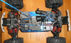 T-maxx 3.3 with chrome mag, new bumpers, new gaz tank, 2 forward speed, 1 reverse speed, opti-drive work good, go really fast, hours of fun in sand and, snow, etc...  Ez-Star starter, tire good condition. R D logics muffler and manual starter include.
