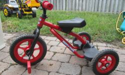 Red trike. Great for boys or girls. Great condition.