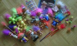 Troll doll collection (all from the early 1990s) More than 25 pieces in collection - varying sizes - Colouring / Sticker Book - Stickers still in sealed packaging (1992) - Pencil, Keychain, and Ring Trolls - Pin Treasure Troll still in sealed packaging