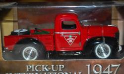Trucks and cars in unopened display boxes. Mint shape. 1947 Red International Canadian Tire Pickup 1936 Yellow/Black Dodge Napa Truck 1947 Yellow International Home Hardware Pickup 1950 Red Ford Canadian Tire Pickup 2003 Dodge Viper SRT-10 1957 Red