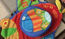 Tummy time airplane mat. Has squeaker, crinkly wings, rattle, etc.