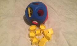 Tupper ware SHAPE-O TOY. This is a classic toy. Great for toddlers and babies