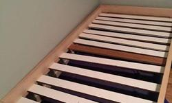 Twin Size Bed made of pine. We used left over wood for the slats, that are adjustable.