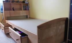Two, twin storage beds, are for sale. Beds are three years old and made of solid birch and birch veneer. We bought the bed sets at SEARS store and paid $1300/per set, plus price of the mattresses. SEARS is still selling it for same price. Beds are in