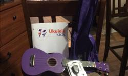 Like new (mint condition) kids ukulele (purple in color), case, electronic tuner, 2 picks and a book of songs. Give your child the gift of learning to play music!
