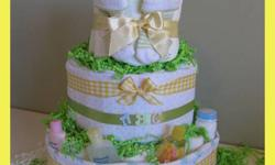 """ADORABLE, UNIQUE & PRACTICAL BABY GIFTS   """"Baby Shower - Welcome Home""""   Custom Designed Diaper Cakes/Gifts handcrafted with (Disposable Diapers) & Quality Baby Products   Please browse our website for your gift giving solutions!! Numerous prices ranges"""