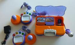 Educational game system by VTech. It is designed for children ages 3 to 6, but offers software designed for several age groups between 3-9. Comes with 8 games, 2 controllers with pens, microphone and adaptor. Can also be used with batteries. The set has