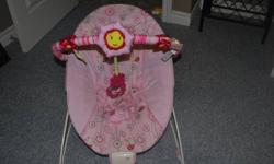 Vibrating bouncy chair...excellent condition...used for a very short time. Purchased at Toys R Us....selling for $20.00 Winnie the Pooh Bathtub - $7.00 Play Mat - $12.00 Microwave Sterilizer - $5.00