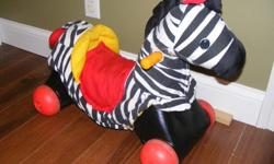 Hello various items for sale from a pet and smoke free home. 1. Rocking and wheels zebra-can be a rocking zebra or base comes off easily to become a riding zebra $10.00 2. Disney mobile Mickey, Minnie, Pluto and Donald spin around to music, winds up no