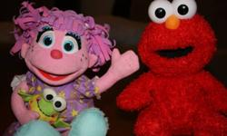 "Elmo Chicken Dance $20.00 Baby Elmo ( makes baby noises and sings ""Elmo is so ticikish lala la la.."" $10 Good night Abby doll says  a few little phrases and sings a lullaby $10.   Pick up in Westwood.....All items work and are in used condition"