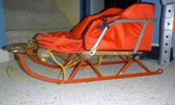 Vintage Spartan baby sled, comes with padding and attached to the padding is a cover that the baby's legs go in for extra warmth.  $35.00 obo.   Call 204-785-2687 or 333-9440 (leave a message if we're not available).  Thanks.