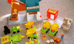 This Fisher Price set contains the Lift and Load Depot as well as the Lumber Yard. Seven vehicles are included - two dumptrucks, two front-end loaders, one truck with hitch and two forklifts. It also comes with seven men with hardhats, a trailer, a road