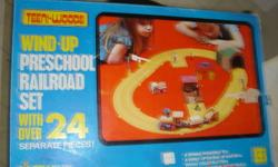 this is a Vintage 1974 Teeni-Woods Wind up Train set comes in original box, also included is a  vintage Fisher Price Little People Wind up  train and truck the train is from about 1972, the other one is from 1974. 45.00 otr best offer see pictures check