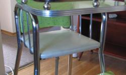 High chair circa 1950s. Arborite tray and footrest, original vinyl covered seat and back, chrome legs. Strap needs replacing and there is a small stain on upper back. Very good overall condition-no rips or dings.
