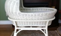 This is a real wicker bassinet in excellent condition. Bassinet easily removable from base. Price firm. Home 250-743-2129 or cell 250-715-8520