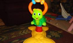 Looks Brand New! Never really used! Lots of fun for the little ones that like to bounce! Lights up and plays music. Teaches colours, songs, abc's.....