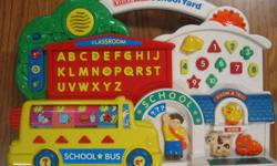 "This is a great learning toy full of different activities. It plays 8 songs; a different one each time you push the school bell and while they play, the sun lights up and blinks to the beat of the song. There are 10 numbers on 10 shapes. The ""classroom"""