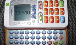 """VTech Slide and Talk Smart Phone. Educational phone teaches letters and numbers, all kinds of noises. Receives and makes call to """"friends"""" Receives text messages. Pretty neat little phone but my daughter has no interest in it. In excellent condition. This"""