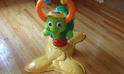 Vtech talking/singing turtle bouncer teaches shapes, colours, and numbers. Clean and in excellent condition. Requires two AA batteries. Smoke free home. States weight limit is 42 pounds. Pick up only; no delivery.