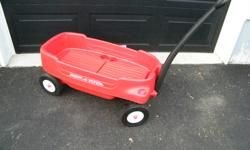 Excellent condition. Always stored inside. Solid rubber tires, 2 seats that fold down - seat belts, cup holders, handle folds underneath for easier storage.