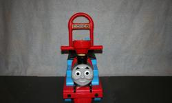 Walk behind / ide on Thomas the Engine which makes train noises and has a horn. Seat lifts up for storage of stuffies or small toyes. No peeling stickers. Pick up only