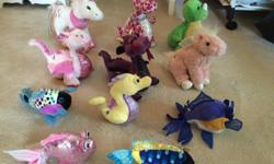 4 dragons, a seahorse, 4 fish, a unicorn, and a Pegasus. Great condition.
