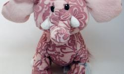 "Dusky pink plush fabric with etched flower pattern is soft and short. Sits 9"" high. New with sealed code, excellent condition!"