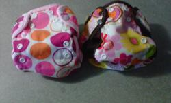 Size 5- 20lbs adjustible covers Like new clean, smoke free and pet free home. 35.00 for both Check out my other ads, I have tons more baby stuff