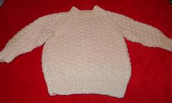 White pullover sweater for 12-18 month old. Cost $12.00  please call 437-6579