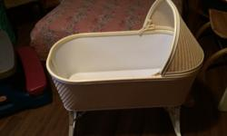 White wicker baby bassinet for sale. The legs fold down for storage. Mattress included. Excellent shape. Only used when visited by grandchildren. Very safe and excellent to place by the bed for nursing mothers. Excellent for a second bed for an infant.