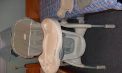 Highchair has two trays and a detachable hood for infant.  Seat tilts back for baby and sits upright for toddler.  Excellent condition. The trays are in perfect condition.