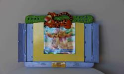 Includes * Holes for holding up to 12 crayons/pencils * Tigger clip for holding paper in place * Trays for drawing pencils, crayons, erasers * Thick lap cushion to place between the tray & child's lap Very good condition