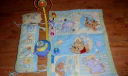 Adorable Winnie the Pooh Bedding and Mobile, Comes with Blanket, sheet, bumperpads and a Mobile with a remote and little nightlight. The mobile plays classical songs, winnie the pooh theme song, and Nature Sounds, the bubble on the front changes colors