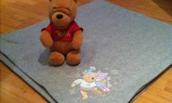 """Both items from the Disney Store. The blanket is in excellent condition and the stuffed Winnie the pooh is in great shape as well. Blanket is 59""""x50""""."""