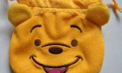 """Brand new, has never been used. We were going with a """"Winnie the Pooh"""" theme, but changed our minds. Asking only $3 or best offer. Great little bag for coins or for snacks for your child. It is very soft and furry. In the shape of Winnie the Pooh's face."""