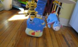 goes on the crib, and tigger poohbear and eyore all go in a circle, and sings a comfortng song to your baby so they can fall aslee or back to sleep ..