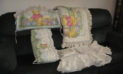 This gorgeous Winnie The Pooh crib set comes with bumper pads, quilt, head board pad, a drape, crib sheet and the bed skirt.  Would make a wonderful addition to baby's room!