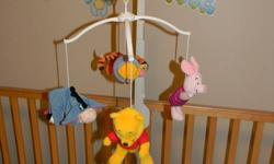 """Winnie The Pooh Mobile   Characters are Pooh, Piglet, Eeyore and Tigger Plays the classic """"Winnie The Pooh"""" song Wind-up style Has an extender you can add that makes mobile taller so it is out of reach of baby fingers Slight yellowish disoloration on the"""