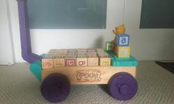 Winnie the Pooh trailer with wooden blocks. My kids loved walking around pulling this trailer with all sorts of things on it. Sadly they have grown out of it and it is looking for a new home.
