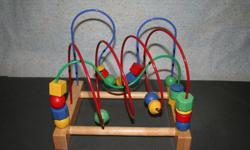 Movable wooden block on wire frame (about a foot high) - lots of fun for baby to develop hand eye coordination. Like new - pick up only