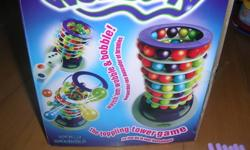 Brand new in box. Purchased from Scholar's Choice. Still has $19.99 sticker on box.   Build a wobbally ball tower and poke out marbles with poking sticks.  First one to knock down tower loses.   Smoke free home in East London, Hamilton and Gore Road area.