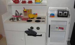 This unique Play Kitchen was lovingly made by my husband and was enjoyed for years by our daughter. It is a good gender-neutral design & colour so great for any girl or boy. Includes a small cabinet that we used as the play fridge for storing food items.
