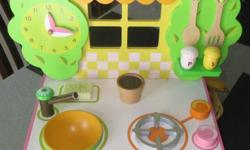 Ze Kitchen from Djeco is a wonderful child's wooden toy that is beautifully painted and features a window to gaze through, a spacious oven, a removable sink with tap and a food preparation area that slides in and out.? There are numerous details such as
