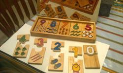 Solid wood Number Puzzle in solid wood case, complete with original box Numbers 0 - 9 (two pieces per each number) Very clean, wood is in perfect condition, no chips, scratches etc. $15