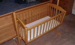 We are done with our wooden bassinet. It can rock or be locked in place. Great for newborns to sleep by mom and dad.  It is in good condition. Call (780) 538-1685 or email for more details