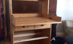 Solid wood baby changing table from Ikea (2000). Excellent surface for diaper and clothing changes. Converts to a bookshelf when you no longer need a change table. The large drawer slides are broken but all drawers are included. You could fix this or