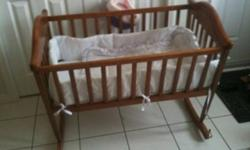 Wooden cradle in great shape. Comes with the white bedding. This ad was posted with the Kijiji Classifieds app.