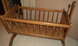 Wooden baby's cradle. Removable crib on hooks.