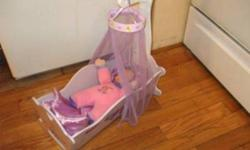 Wooden Doll Cradle with Doll Included. Purple Satin Matteress, Pillow and Cover Canopy with Purple Netting  In Excellent, Clean Condition $25.00