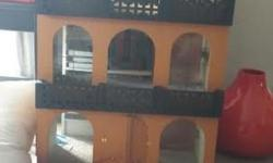 this dollhouse is handmade and over 40+ years old. This is the front of it. There is a picture of the back under the comments section. It offers four levels of play space. It has all been wallpapered and has flooring. The carpet is loose and can be
